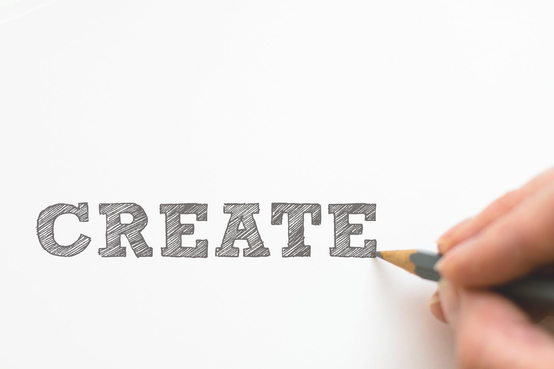 hand writing the word CREATE