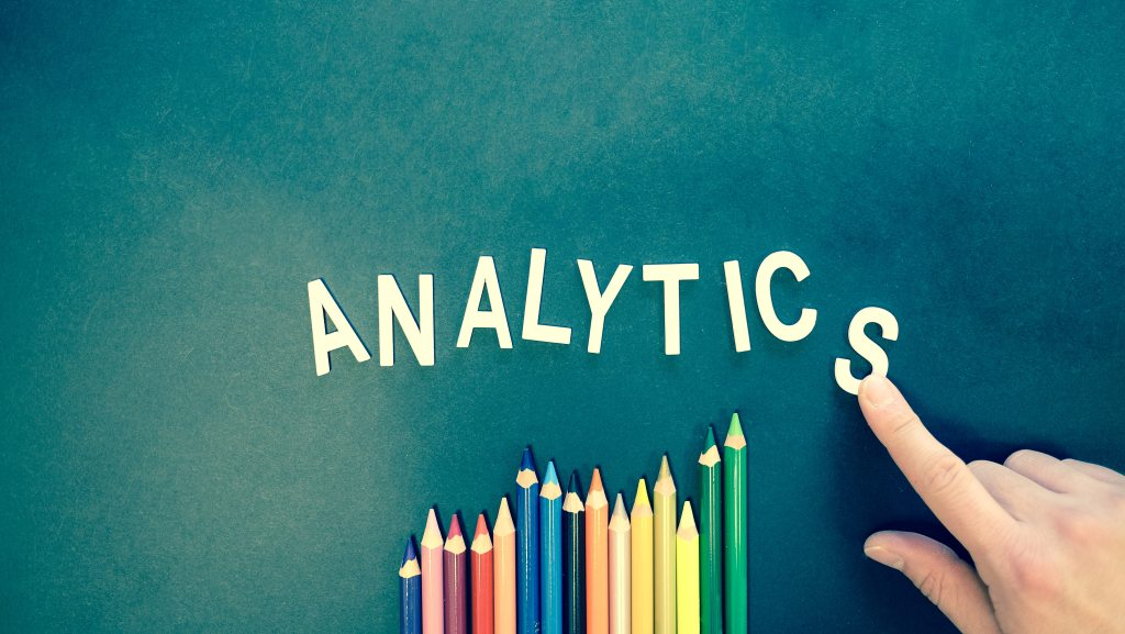 Color pencils with texts made up the word ANALYTICS