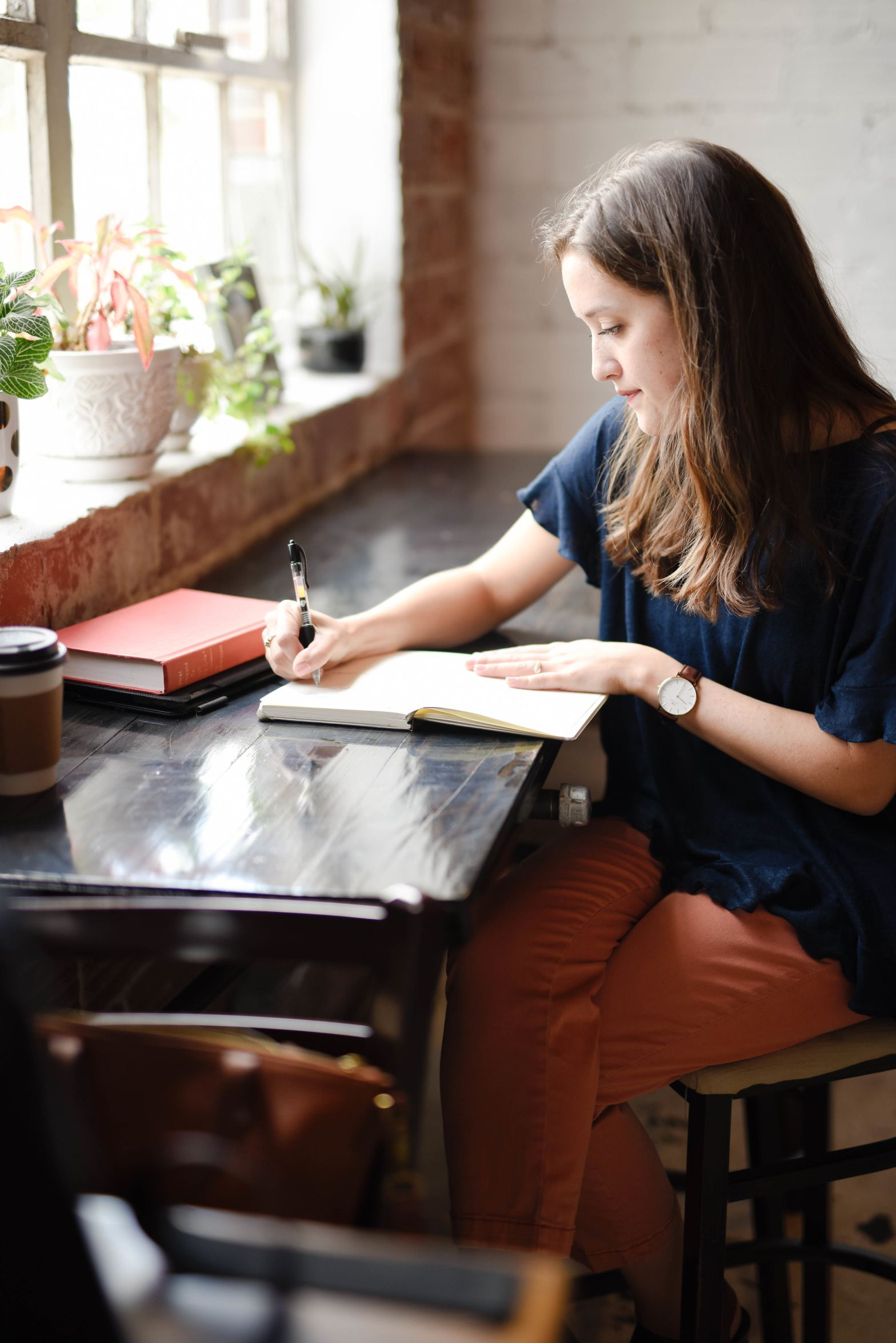girl writing on a notebook at her desk